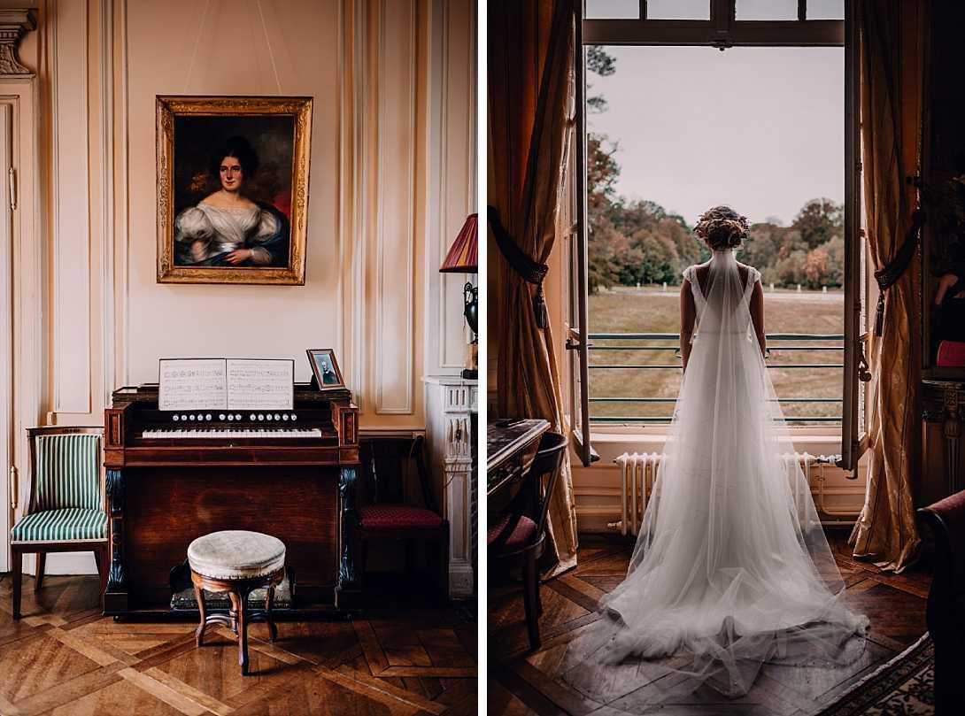 la mariée de dos à la fenêtre du château regardant à l'extérieur