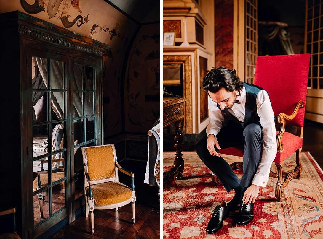 le marié en fin de préparatif, ils enfilent ses chaussures assis dans le cadre du château